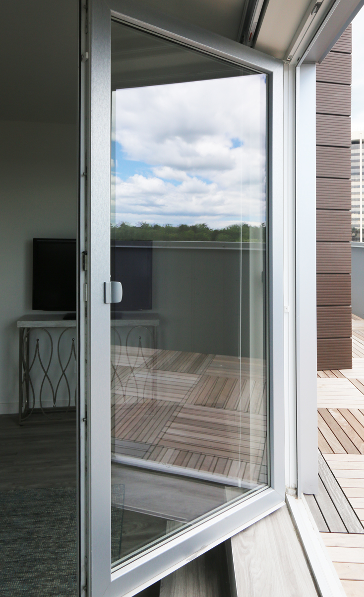 INTUS balcony doors let out to a rooftop with a view